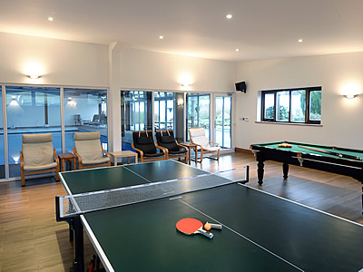 Well equipped games room adjoining large indoor heated swimming pool