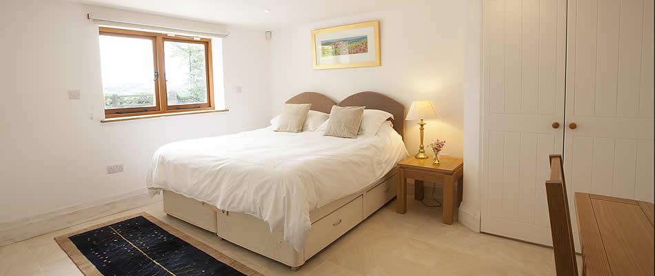 Ground floor bedroom with super king size bed (can be changed to two single beds)