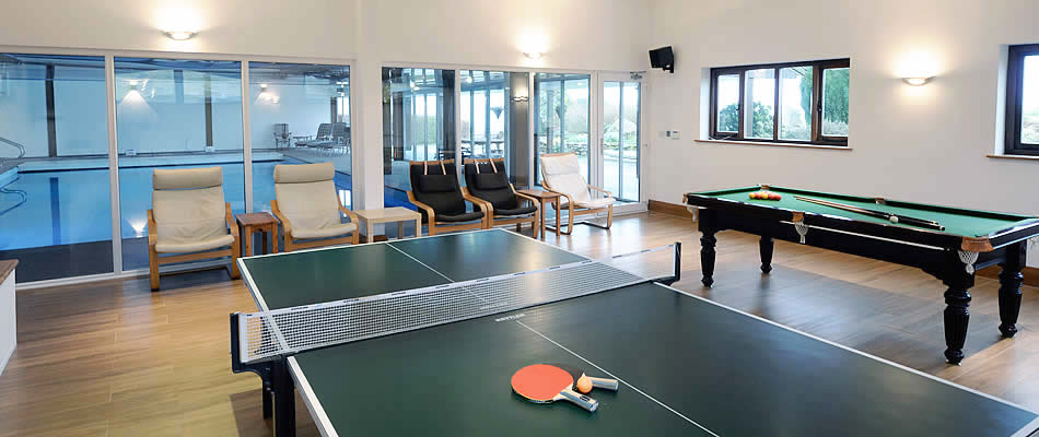 Well equipped games room accessed from the swimming pool