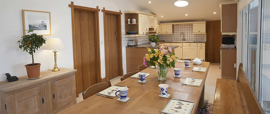 Open plan kitchen area with large dining table